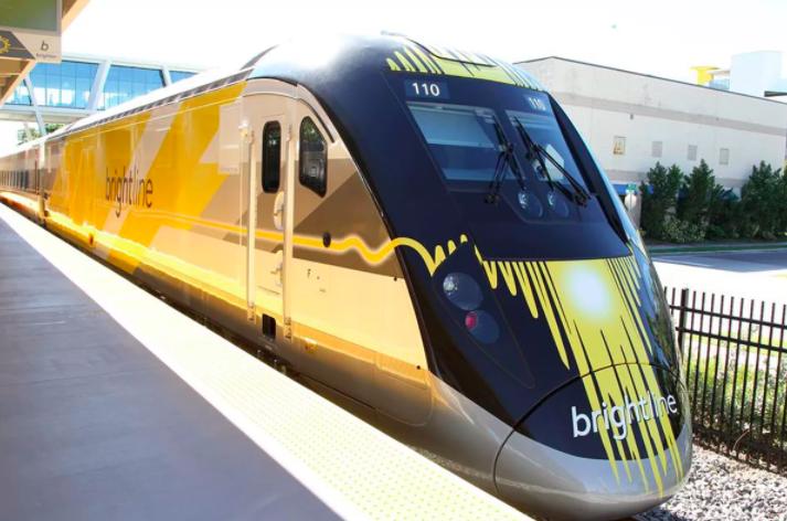 High-Speed Brightline Train Stops At Datura Street